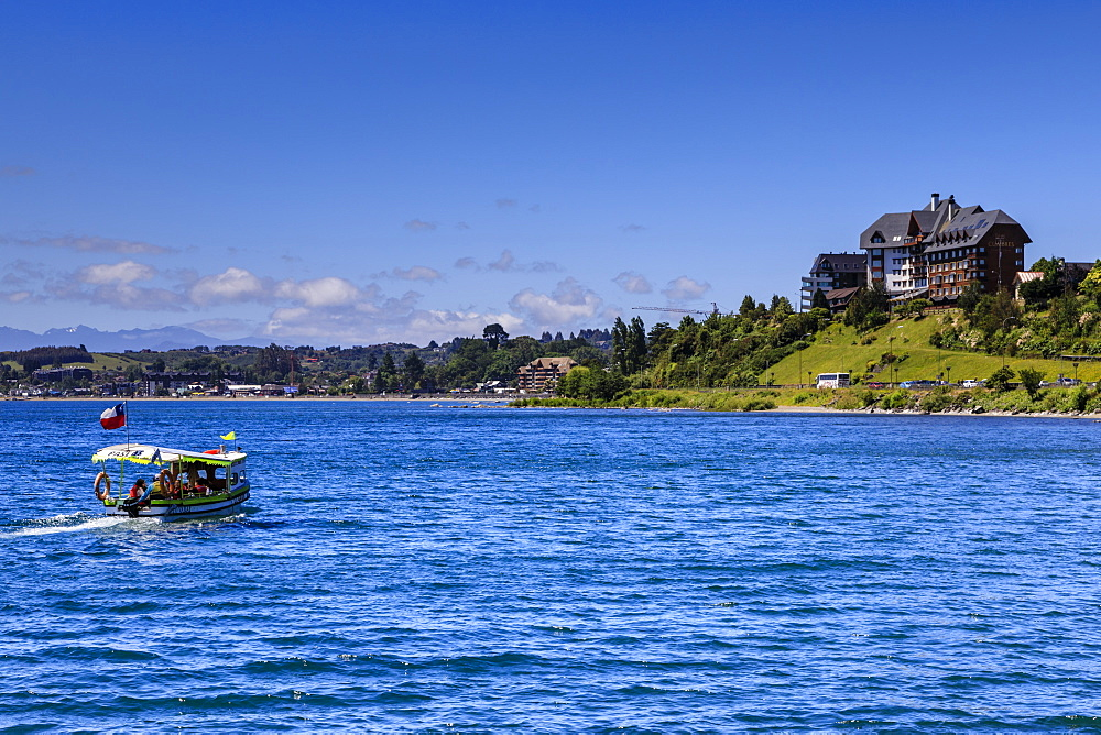 Excursion boat and wooded shoreline, Lake Llanquihue, downtown Puerto Varas, Lakes District, Chile, South America