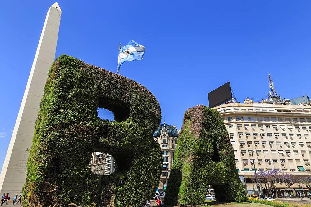 BA in topiary, Obelisco iconic monument and flag, Plaza de la Republica, Congreso and Tribunales, Buenos Aires, Argentina, South America