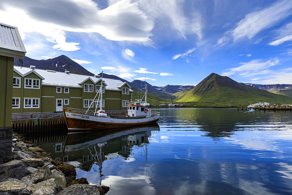 Fishing boat, hotel, mountain and fjord scenery, Siglufjordur, (Siglufjorour), stunning Summer weather, North Iceland, Europe