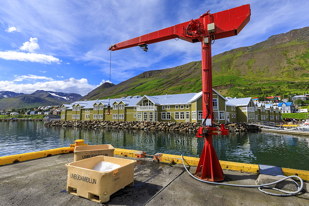Fishing crates and equipment on quay, mountains and town, Siglufjordur, (Siglufjorour), stunning Summer weather, North Iceland, Europe