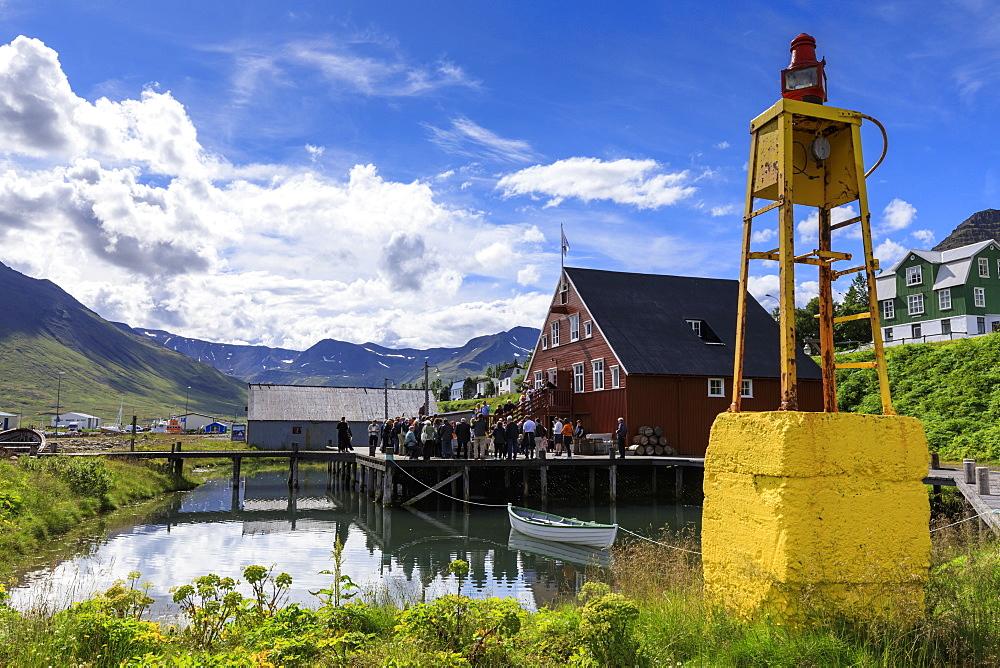 Tourists at the busy, award-winning Herring Era Museum, Siglufjordur, (Siglufjorour), stunning Summer day, North Iceland, Europe