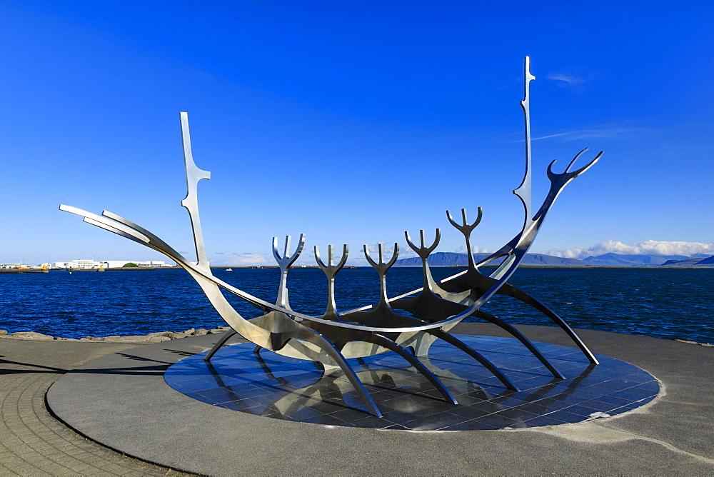 Sun Voyager (Solfar) sculpture by Jon Gunnar Arnason, skeletal ship on the sea shore, Summer, Central Reykjavik, Iceland, Europe