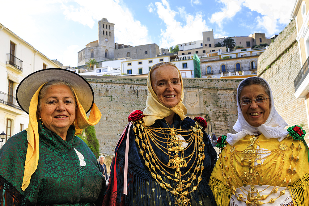 Three smiling ladies in traditional dress, Dalt Vila old town, UNESCO World Heritage Site, Ibiza Town, Ibiza, Balearic Islands, Spain, Mediterranean, Europe