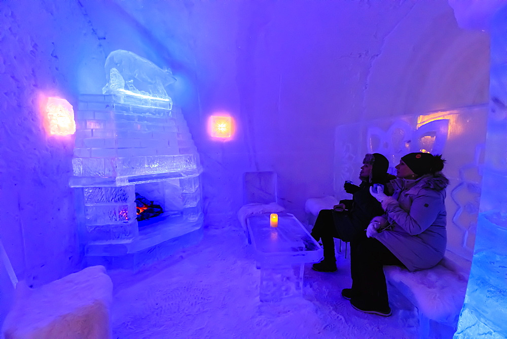 Sorrisniva Igloo Hotel, ice hotel, striking sculpture, cosy fire in ice bar in winter, Alta, Finnmark, Arctic Circle, Norway, Scandinavia, Europe
