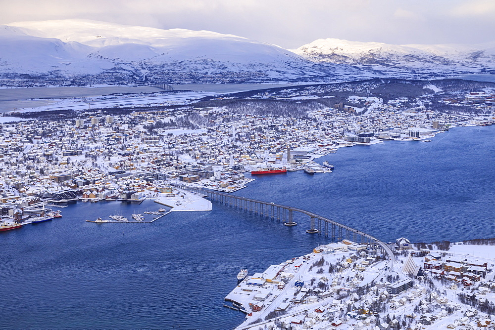Tromso, Tromsoya and fjord, after heavy snow, elevated view from Mount Storsteinen in winter, Tromso, Troms, Arctic North Norway, Scandinavia, Europe