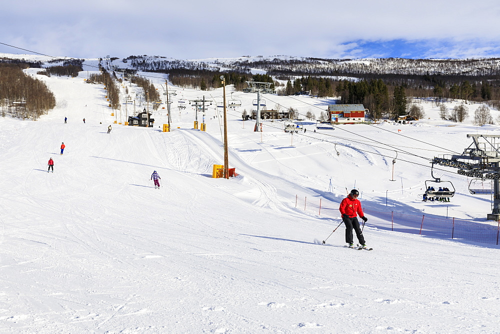 Bjorli Village, skiers, piste and chair lift, early snow ski resort, winter sun, Gudbrandsdalen Valley, Oppland, Norway, Scandinavia, Europe