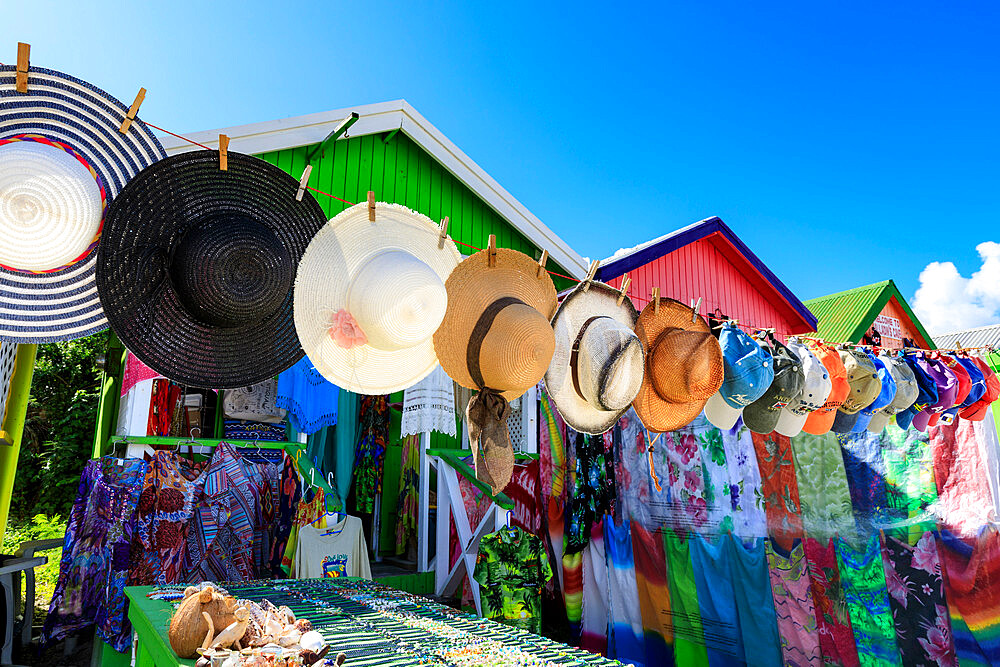 Long Bay Beach, colourful tourist souvenir stall and beach huts, blue sky, Antigua, Antigua and Barbuda, Leeward Islands, West Indies, Caribbean, Central America