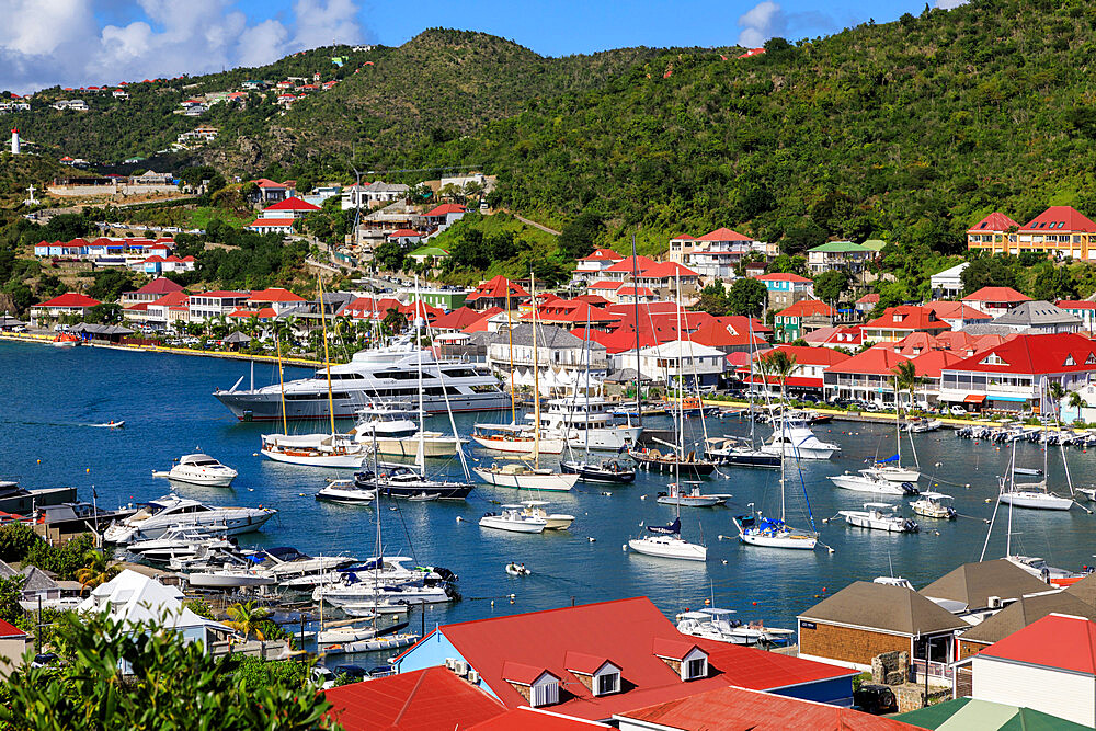 Elevated view, harbour, red rooftops and wooded hills, Gustavia, St. Barthelemy (St. Barts) (St. Barth), West Indies, Caribbean, Central America