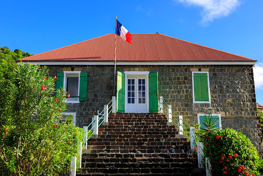 Old Swedish Jail, French flag, flowering shrubs, Gustavia, St. Barthelemy (St. Barts) (St. Barth), West Indies, Caribbean, Central America