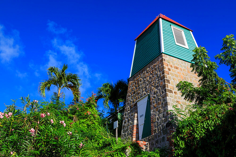 Swedish Bell Tower, palm trees and flowering shrubs, Gustavia, St. Barthelemy (St. Barts, St Barth), West Indies, Caribbean