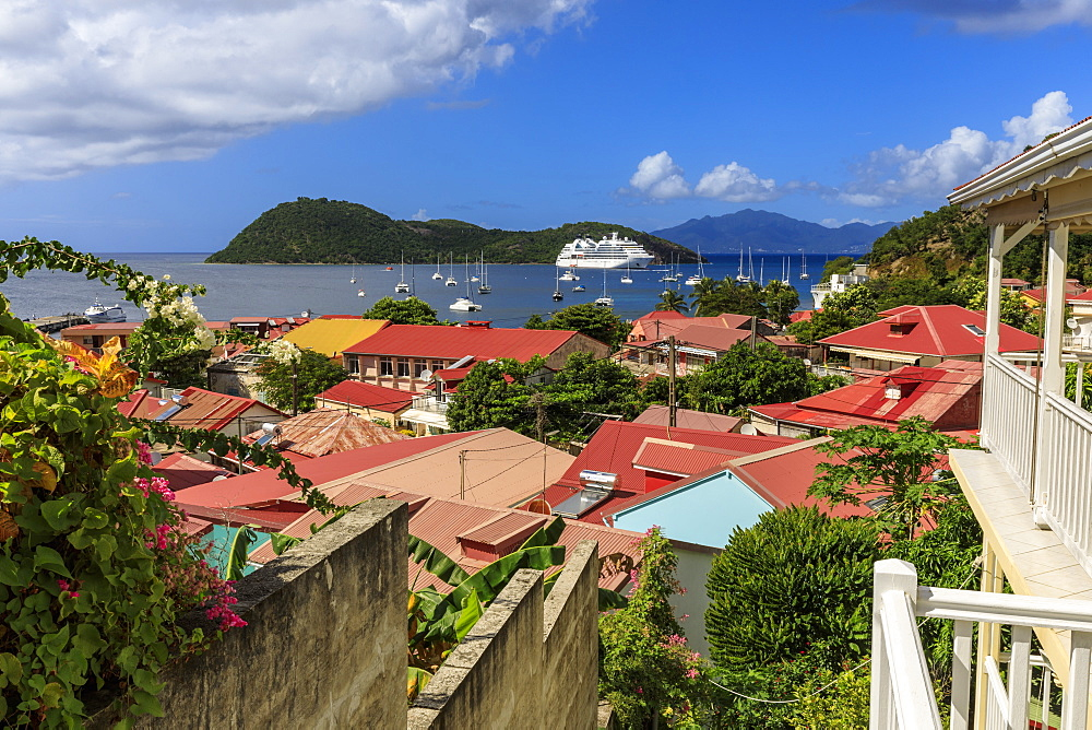 View to beautiful Les Saintes Bay across red roofs of town, Terre de Haut, Iles Des Saintes, Guadeloupe, Leeward Islands, West Indies, Caribbean, Central America