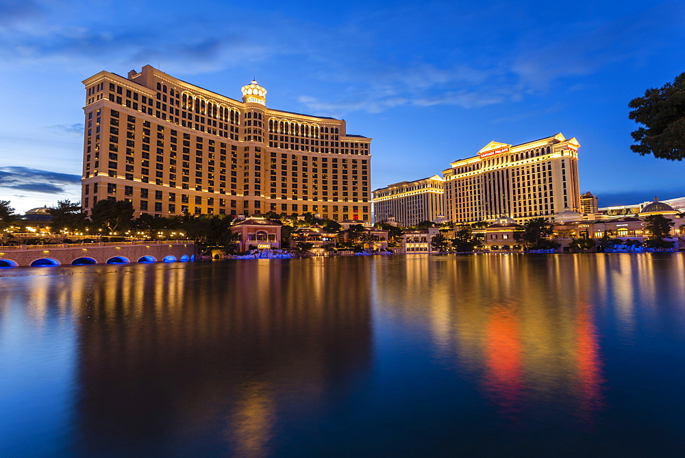 Bellagio and Caesars Palace reflections at dusk, The Strip, Las Vegas, Nevada, United States of America, North America