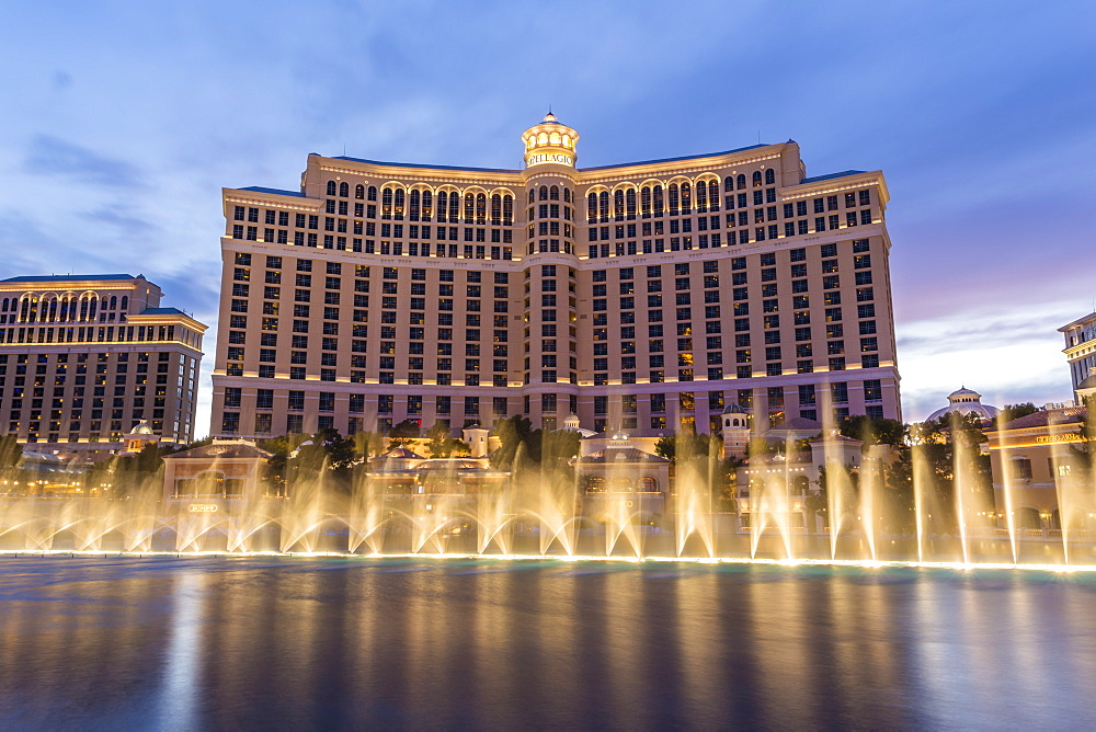 Bellagio at dusk with fountains, The Strip, Las Vegas, Nevada, United States of America, North America