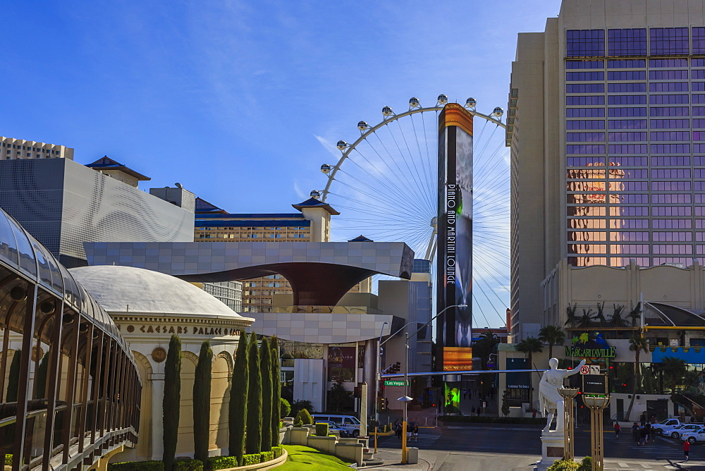 View across The Strip from Caesars, with Caesars walkway and High Roller Observation Wheel, Las Vegas, Nevada, United States of America, North America