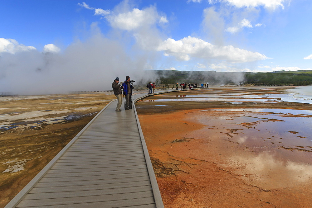 Tourist taking a photograph of Grand Prismatic Spring, Midway Geyser Basin, Yellowstone National Park, UNESCO World Heritage Site, Wyoming, United States of America, North America