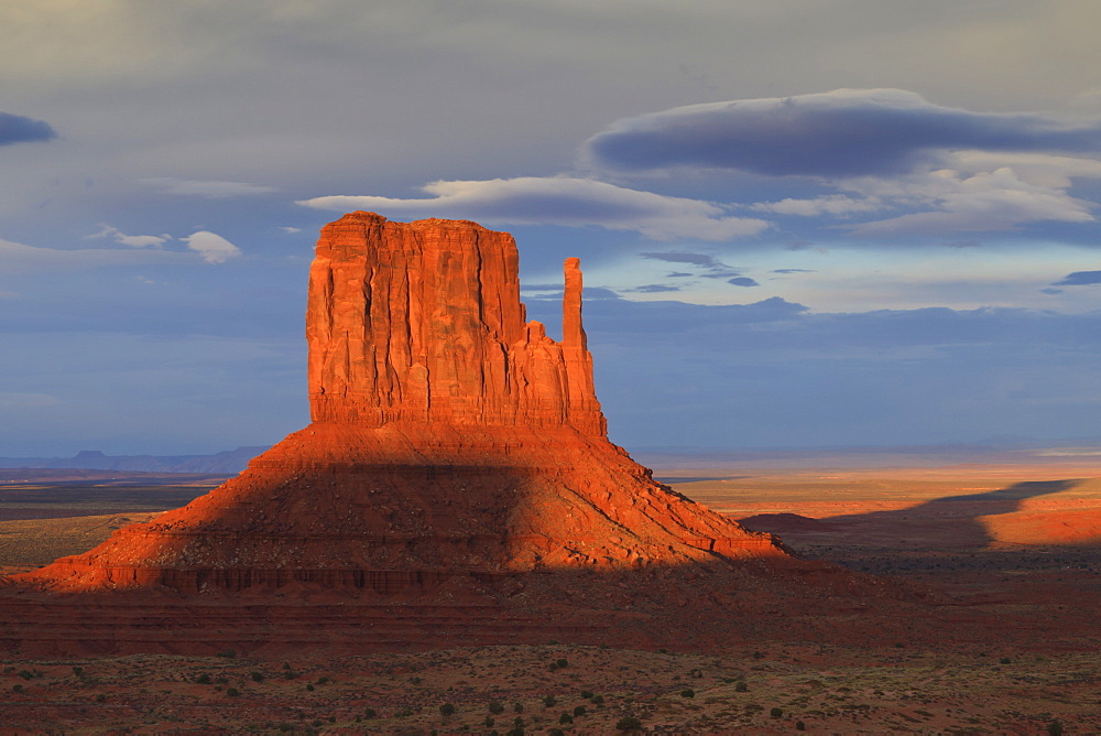 One of the Mittens at dusk casts a long shadow, Monument Valley Navajo Tribal Park, Utah and Arizona border, United States of America, North America