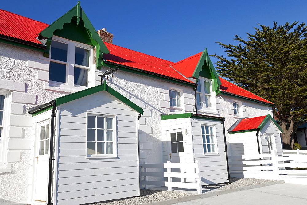 Red and white stone houses of Marmont Row, Victory Green, Stanley, Port Stanley, East Falkland, Falkland Islands, South America