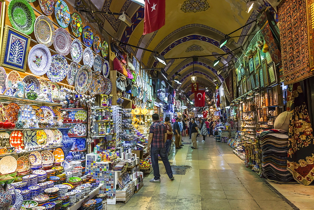 Shops and sellers (vendors) selling Turkish pottery, carpets, kilims, Grand Bazaar, Istanbul, Turkey, Europe