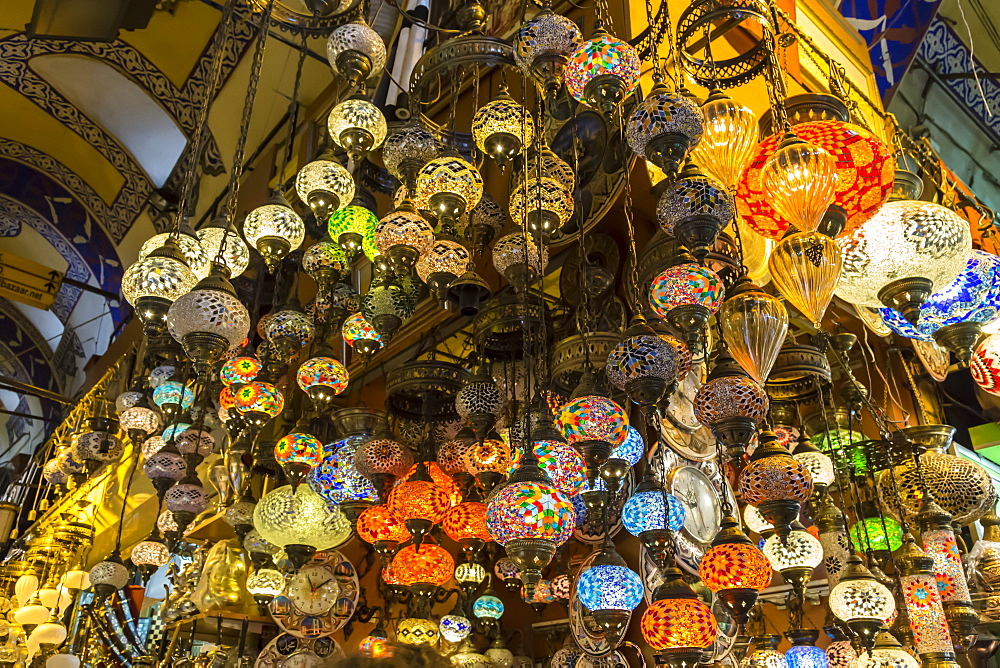 Many hanging and lit colourful and decorative Turkish glass light shades in a shop, Grand Bazaar, Istanbul, Turkey, Europe