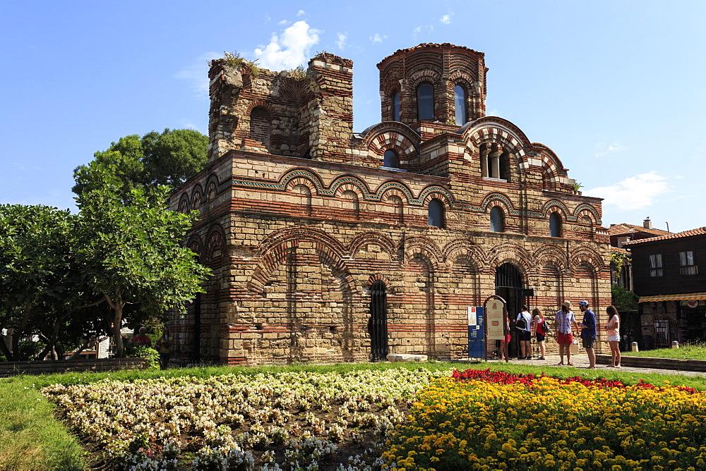 Flower border and visitors, Church of Christ Pantokrator, Nesebar (Nessebar), UNESCO World Heritage Site, Black Sea Coast, Bulgaria, Europe