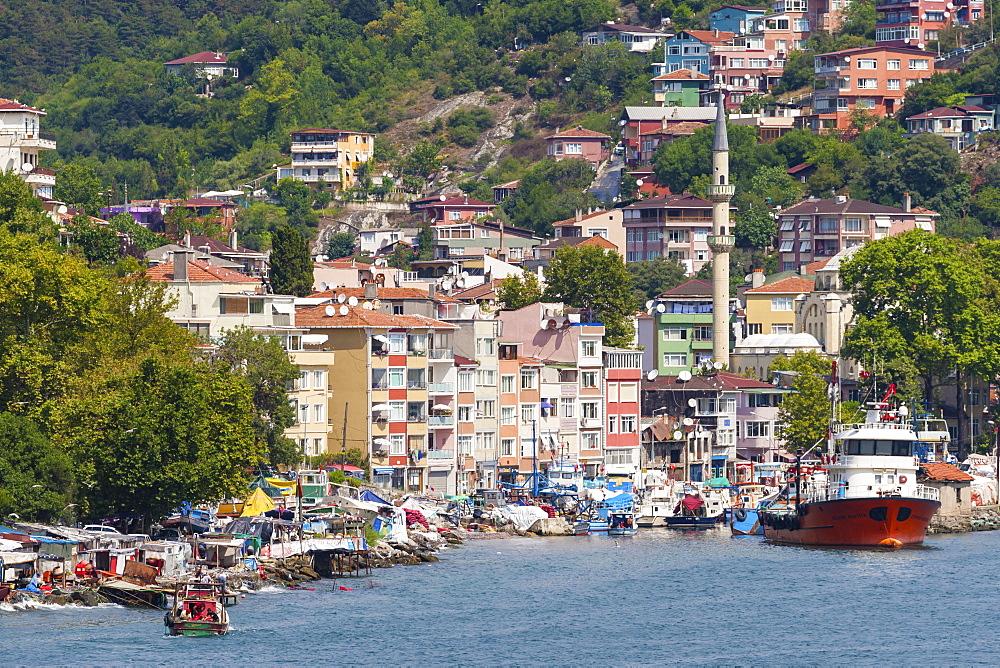 Fishermen and fishing boats, minaret and apartments, Rumeli Kavagi, Upper Bosphorus Strait (European Side), Istanbul, Turkey, Europe