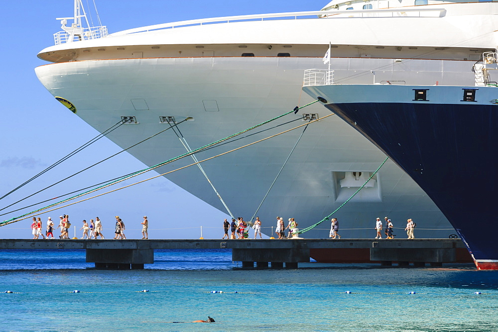 Cruise ships and disembarking passengers, with snorkeler in azure sea, cruise terminal, Grand Turk, Turks and Caicos, West Indies, Caribbean, Central America