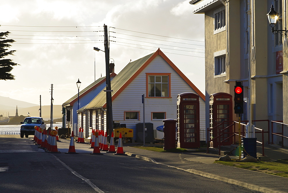 Post office, red telephone boxes, cones and traffic light, waterfront, Stanley, East Falkland, Falkland Islands, South America