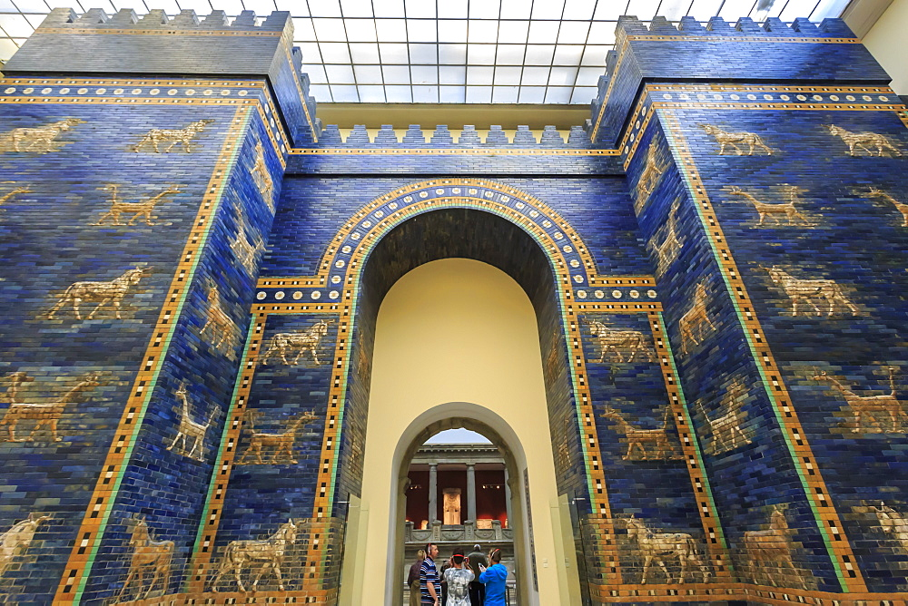 Visitors with audio guides pass through Ishtar Gate (Babylon), Pergamonmuseum (Pergamon Museum), Museum Island, Berlin, Germany, Europe