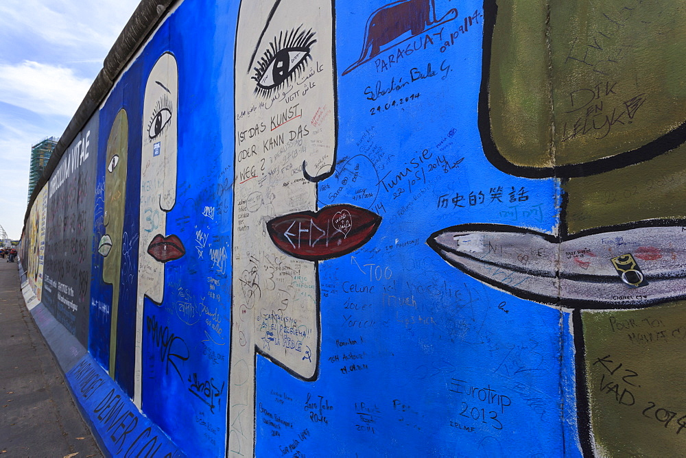 Graffiti on mural Tolerance by Mary Mackey, Berlin Wall, East Side Gallery, Muhlenstrasse, Friedrichshain, Berlin, Germany, Europe