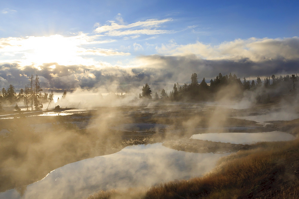 Freezing mists, dawn, West Thumb Geyser Basin, Yellowstone National Park, UNESCO World Heritage Site, Wyoming, United States of America, North America
