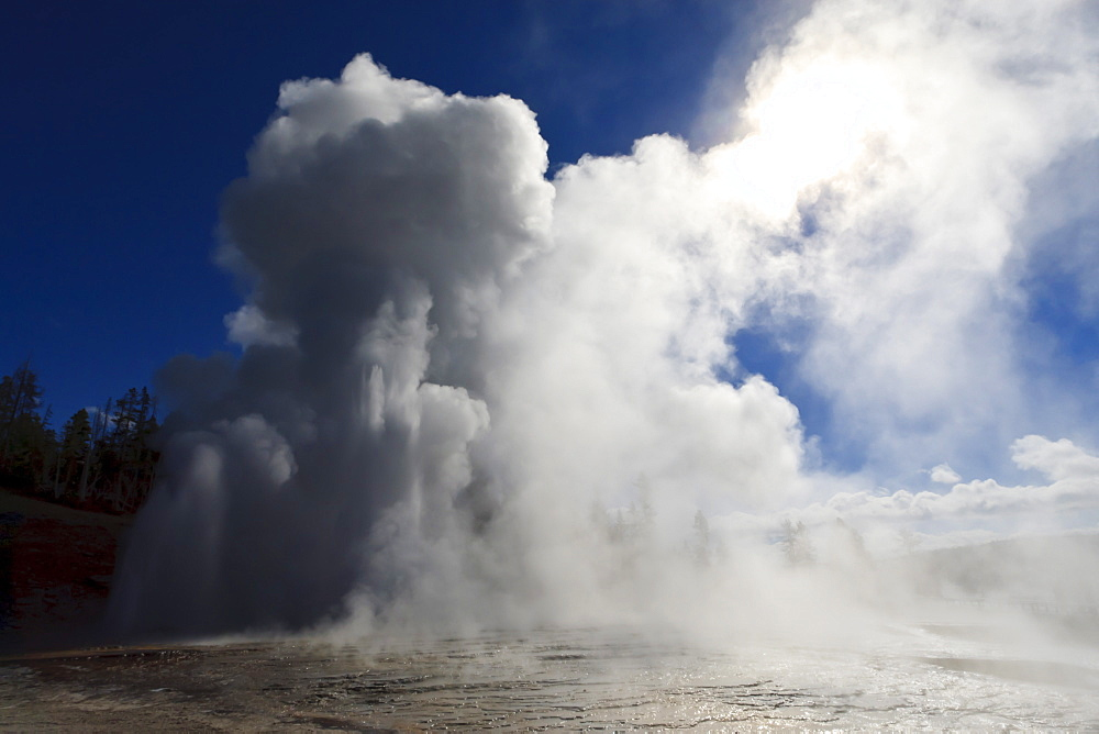 Grand Geyser erupts and steam blocks the sun, Upper Geyser Basin, Yellowstone National Park, UNESCO World Heritage Site, Wyoming, United States of America, North America