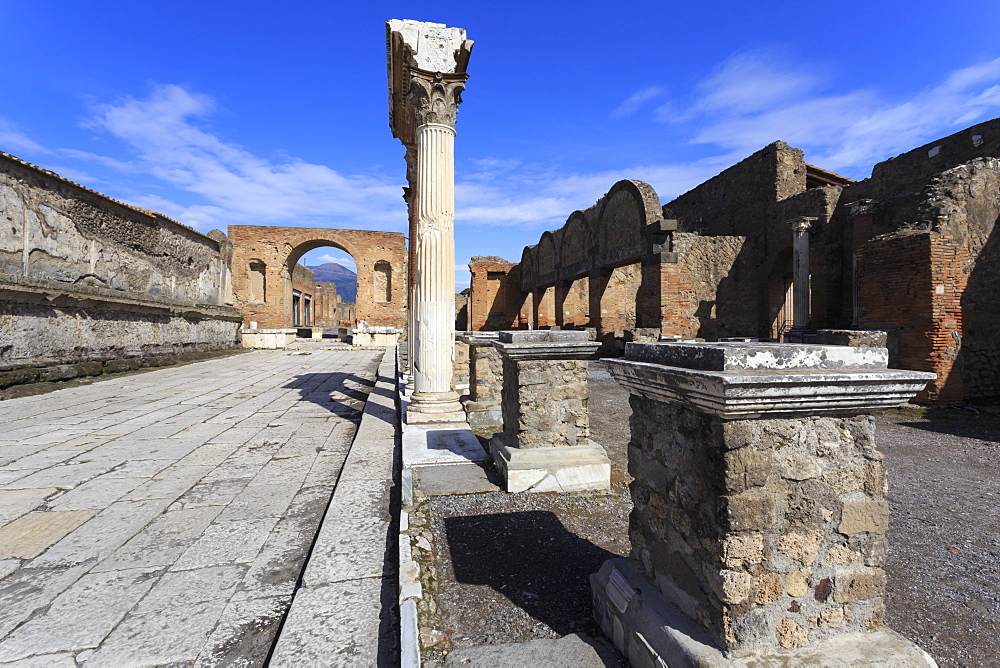 Forum and Vesuvius through arch, Roman ruins of Pompeii, UNESCO World Heritage Site, Campania, Italy, Europe