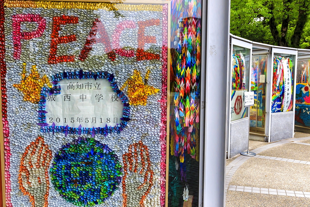 Symbolic brightly coloured paper cranes forming the word peace, Children's Peace Memorial, Peace Memorial Park, Hiroshima, Japan, Asia