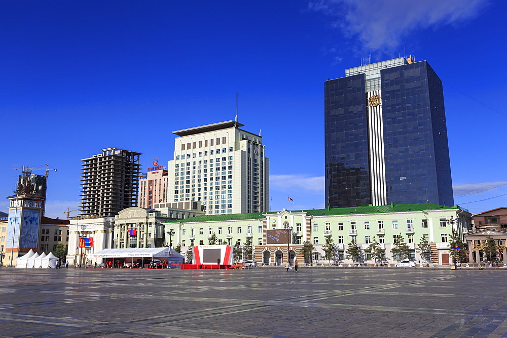 Old and new buildings around Chinggis Khaan (Sukhbaatar) Square under blue sky, morning, Ulaanbaatar (Ulan Bator), Mongolia, Central Asia, Asia