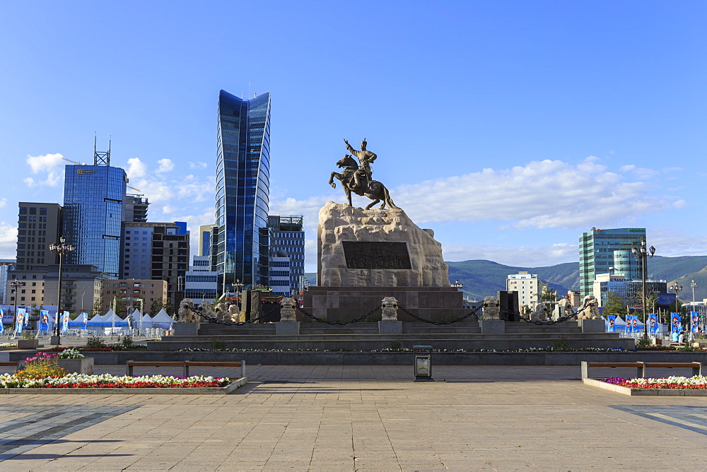 Statue of Sukhbaatar on horse, with new development behind, blue sky, Chinggis Khaan Square, Ulaanbaatar (Ulan Bator), Mongolia, Central Asia, Asia