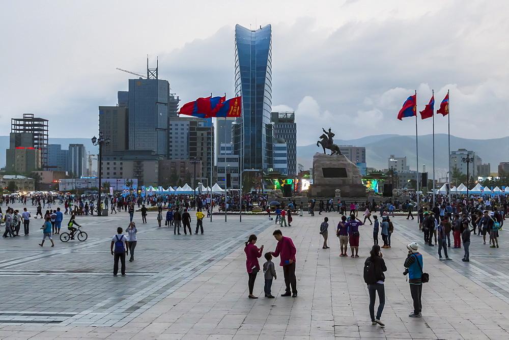 Busy Chinggis Khaan (Sukhbaatar) Square, evening, Naadam Festival weekend, Ulaanbaatar (Ulan Bator), Mongolia, Central Asia, Asia
