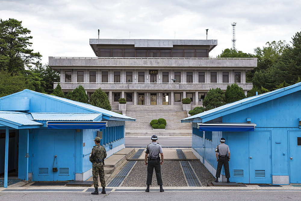 ROK soldiers and blue UN buildings face North Korea, Panmunjom, Joint Security Area (JSA), North and South Korea border, Asia