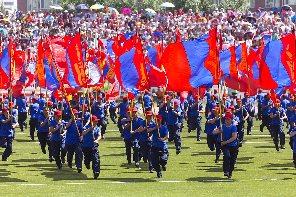 Young men run with Mongolian flags, Naadam Stadium, Naadam Festival Opening Ceremony, Ulaan Baatar (Ulan Bator), Mongolia, Central Aisa, Asia