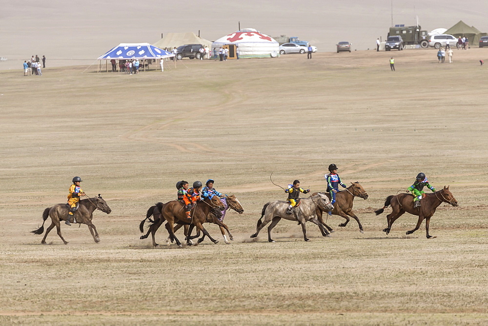 Child jockeys in a dash for the line, five-year old horse race, Naadam Festival, Hui Doloon Khutag, Ulaan Baatar, Mongolia, Central Asia, Asia