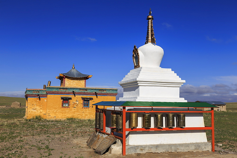 Colourful small temple and vibrant stupa in countryside under blue sky in summer, Dundgov, North Gobi, Mongolia, Central Asia, Asia