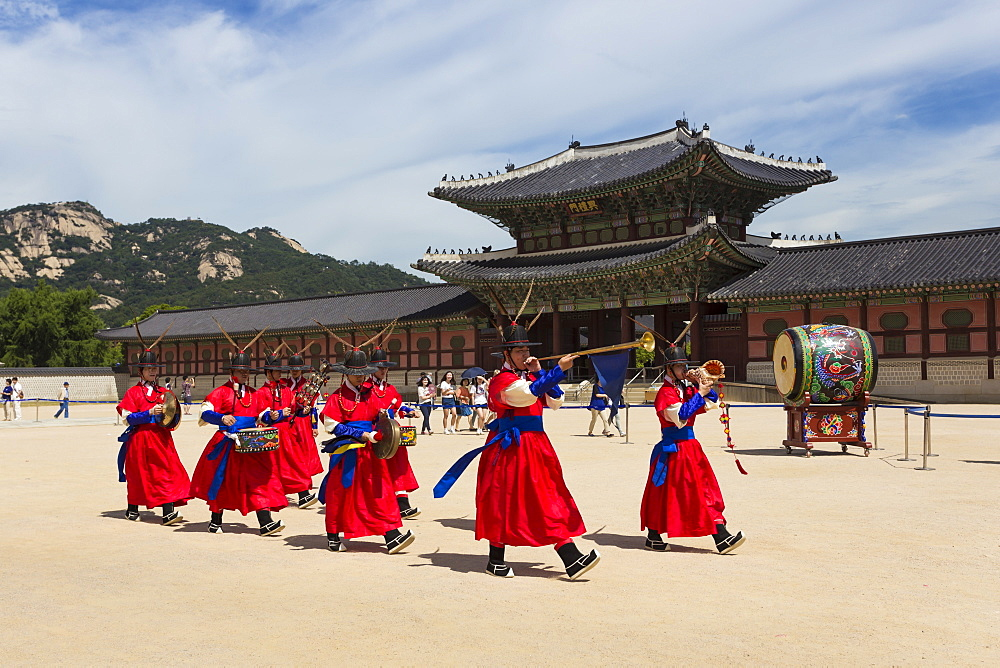 Marching band in bright traditional dress, colourful Changing of the Guard Ceremony, Gyeongbokgung Palace, Seoul, South Korea, Asia