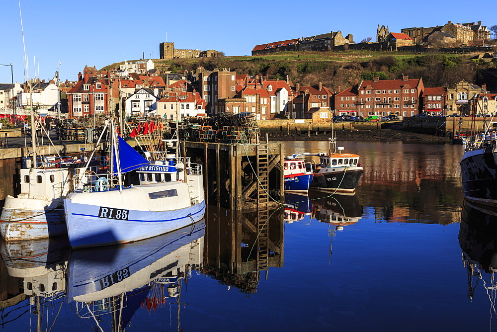 St. Mary's Church and reflections at Endeavour Wharf with lobster pots and boats, Upper Harbour, Whitby, North Yorkshire, England, United Kingdom, Europe