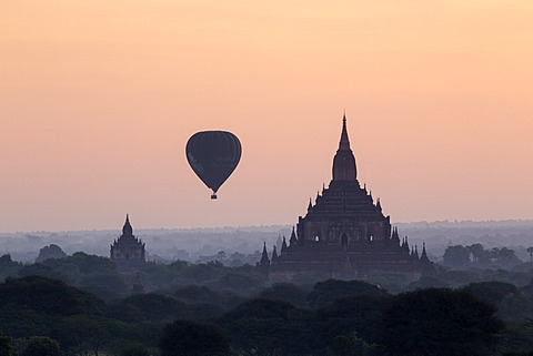 Hot air balloon over temples on a misty morning at dawn, Bagan (Pagan), Myanmar (Burma), Asia - 1170-138