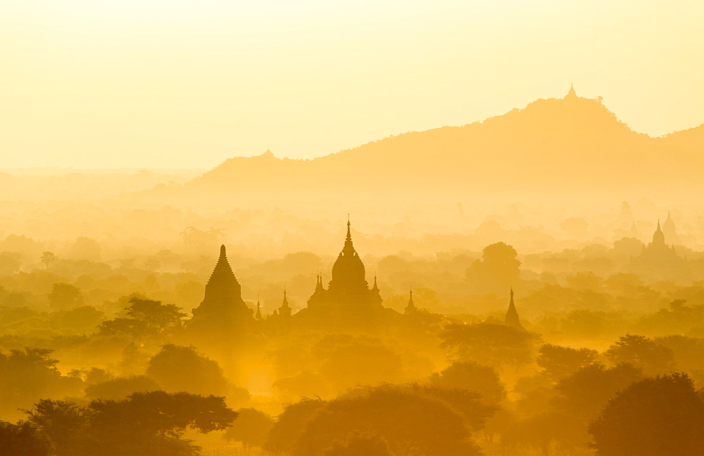 Temples, pagodas and stupas rising out of misty morning landscape at dawn, Bagan (Pagan), Myanmar (Burma), Asia - 1170-139