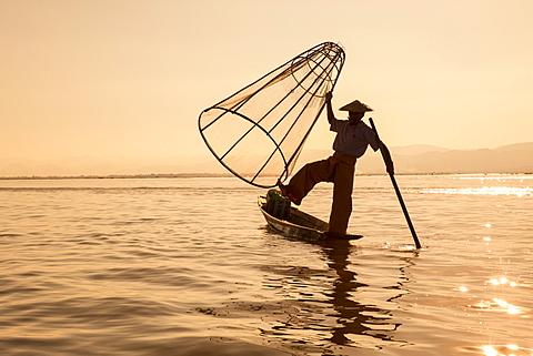 Intha leg rowing fisherman at sunrise, Inle Lake, Nyaung Shwe (Nyaungshwe), Shan State, Myanmar (Burma), Asia - 1170-143