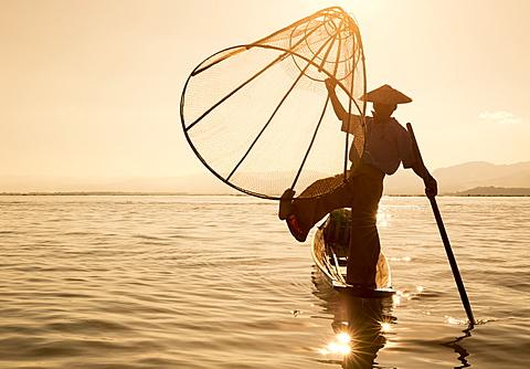 Intha leg rowing fisherman at sunrise, Inle Lake, Nyaung Shwe (Nyaungshwe), Shan State, Myanmar (Burma), Asia - 1170-144