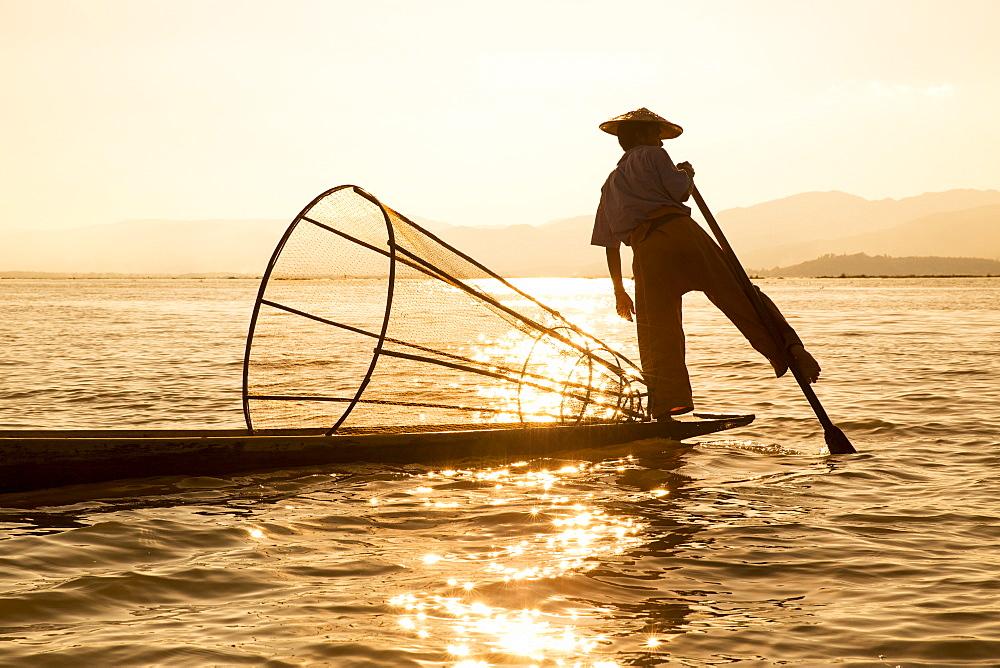 Intha leg rowing fisherman at sunrise, Inle Lake, Nyaung Shwe (Nyaungshwe), Shan State, Myanmar (Burma), Asia - 1170-145