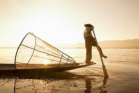 Intha leg rowing fisherman at sunrise, Inle Lake, Nyaung Shwe (Nyaungshwe), Shan State, Myanmar (Burma), Asia - 1170-150