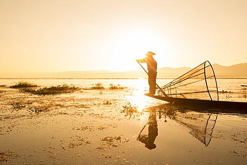 Intha leg rowing fisherman at sunrise, Inle Lake, Nyaung Shwe (Nyaungshwe), Shan State, Myanmar (Burma), Asia - 1170-153