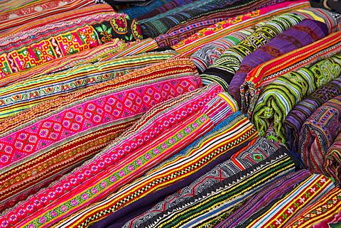 Colourful fabrics for sale at Bac Ha market, Sapa region, Lao Cai Province, Vietnam, Indochina, Southeast Asia, Asia